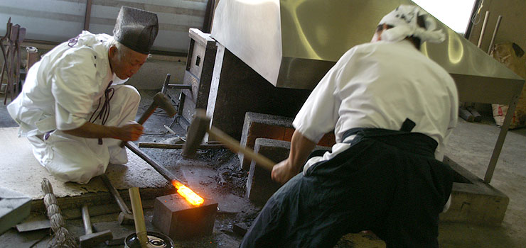 Sword making masters forging a new katana in Seki.